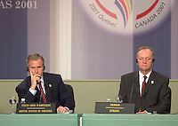 April 22,  2001, Quebecl, Quebec, Canada<br /> <br /> George W, Bush, United States of Americas President (R) and Jean Chretien, Canada's Prime Minister (L) listen to a journalist's question at the closing press conference of the Summit of the Americas , April 22, 2001 in Quebec City, CANADA.<br /> <br /> Both leader agreed to meet before the upcoming G-8 meeting this spring in Alberta, Canada.