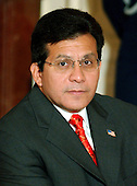 Washington, DC - September 29, 2005 -- Attorney General Alberto Gonzales awaits the ceremony where John Glover Roberts, Jr. was sworn-in as the 17th Chief Justice of the United States in the East Room of the White House in Washington, D.C. on September 29, 2005.  .Credit: Ron Sachs / CNP