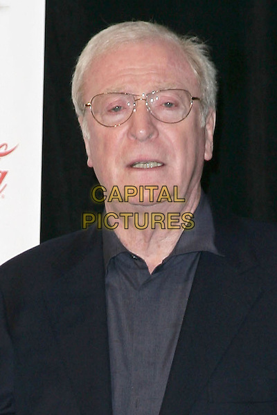 SIR MICHAEL CAINE .ShoWest 2009 Convention Final Night Banquet and Awards Ceremony held at Theatre of the Arts at Paris Resort Hotel and Casino, Las Vegas, Nevada, USA, .02 April 2009. .portrait headshot glasses blue navy grey gray .CAP/ADM/MJT.©MJT/Admedia/Capital Pictures