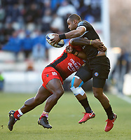 Aled Brew of Bath Rugby looks to offload the ball after being tackled. European Rugby Champions Cup match, between RC Toulon and Bath Rugby on December 9, 2017 at the Stade Mayol in Toulon, France. Photo by: Patrick Khachfe / Onside Images