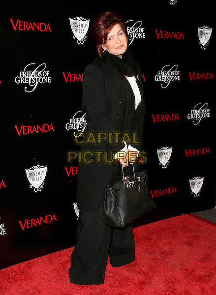 SHARON OSBOURNE .The Veranda Magazine Presentation of The Great House at The Historic Greystone Estate in Beverly Hills, California, USA. .October 30th, 2008.full length black jacket trousers scarf bag purse wide leg.CAP/DVS.©Debbie VanStory/Capital Pictures.