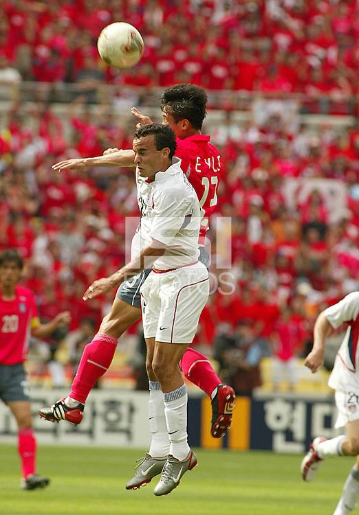Landon Donovan falls short on a header. The USA tied South Korea, 1-1, during the FIFA World Cup 2002 in Daegu, Korea.