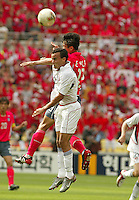 Landon Donovan falls short on a header. The USA tied South Korea, 1-1, during the FIFA World Cup 2002 in Daegu, Korea.
