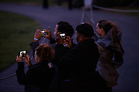Guests take videos as US President Donald J. Trump arrives via Marine One on the South Lawn of the White House  in Washington DC, USA, 02 December 2017. President Trump was returning from a fundraising trip to New York.<br /> Credit: Shawn Thew / Pool via CNP /MediaPunch