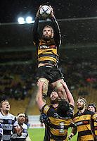 Taranaki number eight Jarrad Hoeta claims lineout ball. Air New Zealand Cup rugby match - Taranaki v Auckland at Yarrows Stadium, New Plymouth, New Zealand. Friday 9 October 2009. Photo: Dave Lintott / lintottphoto.co.nz
