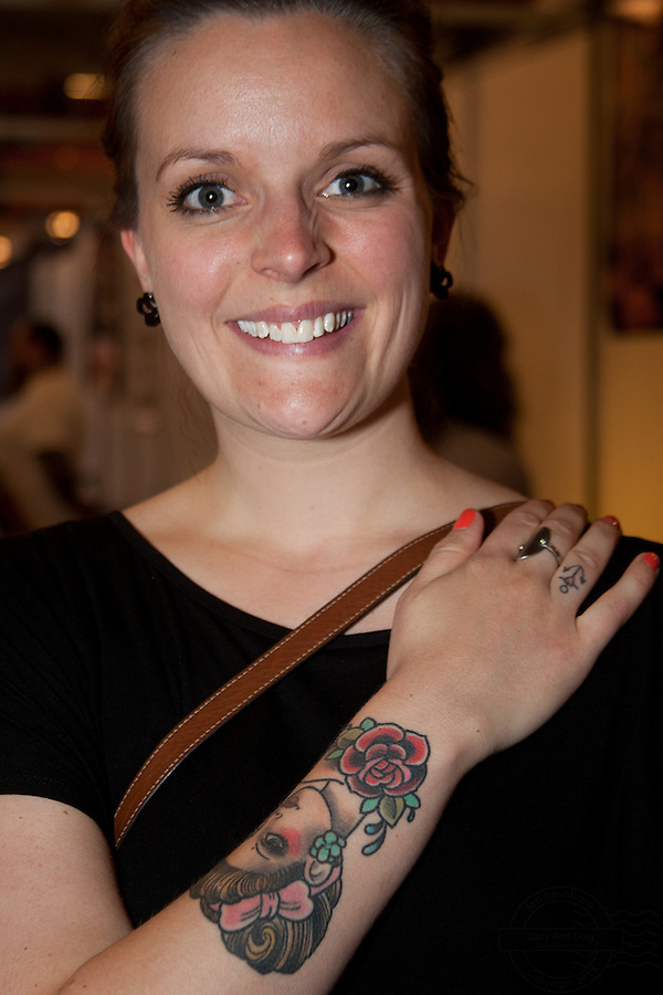 Copenhagen Inkfestival 2012. Young danish woman with old style portrait on arm.