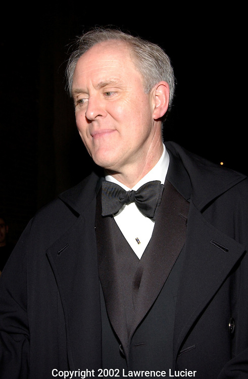 Actor John Lithgow departs the debut of Sweet Smell of Success March 14, 2002, in New York.  The musical is a Broadway adaptation of the film of the same name..