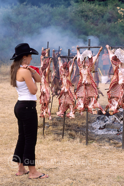 Lamb cooking around an Open  Fire Pit at the Annual Lamb Barbecue on Saturna Island, in the Southern Gulf Islands of British Columbia, Canada