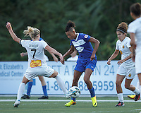 Boston Breakers forward Lianne Sanderson (10) dribbles in  a crowd. In a National Women's Soccer League (NWSL) match, Boston Breakers (blue) tied Western New York Flash (white), 2-2, at Dilboy Stadium on August 3, 2013.