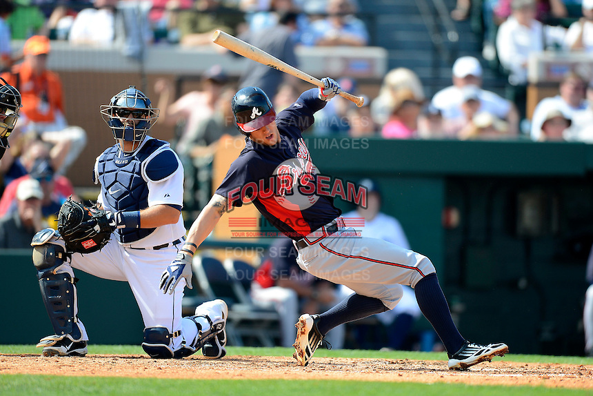 Atlanta Braves outfielder Jordan Schafer #17 avoids an inside pitch as Alex Avila #13 looks on during a Spring Training game against the Detroit Tigers at Joker Marchant Stadium on February 27, 2013 in Lakeland, Florida.  Atlanta defeated Detroit 5-3.  (Mike Janes/Four Seam Images)