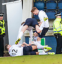 Raith Rovers' Lewis Vaughan (hidden) is congratulated by team mates after he scores their second goal.