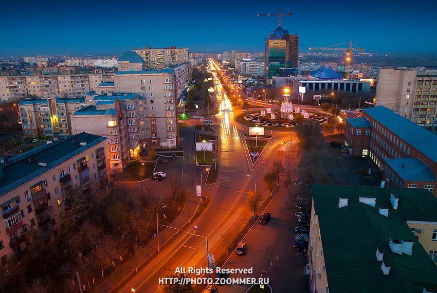Газпром Добыча Оренбург и улица Чкалова вечером