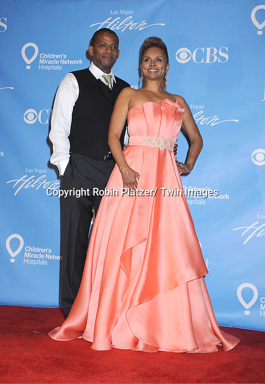 Darnell Williams and Debbi Morgan posing in the press room at the 38th Annual Daytime Emmy Awards  on June 19, 2011 at The Las Vegas Hilton in Las Vegas Nevada. ..