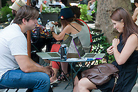 Computer users in Bryant Park in New York take advantage of the free wireless internet access on Wednesday, July 24, 2012.  (© Richard B. Levine)