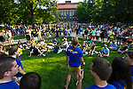 A co-ed glee club draws their own adoring crowd amongst the throngs of students packing the Diag before a football pep rally, Friday, Sept. 2, 2011 in Ann Arbor, Mich. (Tony Ding for The New York Times)