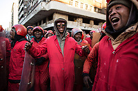 Members of the Red Ants sing and cheer after finishing a large eviction. Six hundred Red Ants were brought in to evict residents of a 10-storey hijacked building called Fatti's Mansions on Jeppe Street in the Johannesburg CBD. The Red Ants are a controversial private security company often hired to clear squatters from land and so-called 'hijacked' properties.