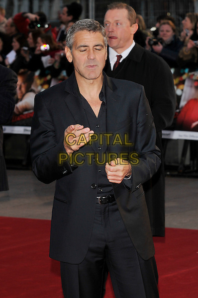 "GEORGE CLOONEY.Attending the ""Leatherheads"" European Film Premiere  held at the Odeon cinema, Leicester Square London, England, 8th April 2008..half length black suit jacket shirt hand funny eyes shut .CAP/PL.©Phil Loftus/Capital Pictures..."