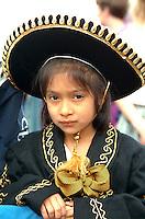 Girl age 6 wearing ethnic attire for Cinco de Mayo Festival Parade.  St Paul  Minnesota USA