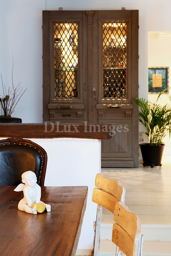 Evi Adam, a successful model, decided with her husband ten years ago to buy this house in the district of Drosia in Athens. The house has a Swedish Country style, surrounded by trees in an impressive green scenery.