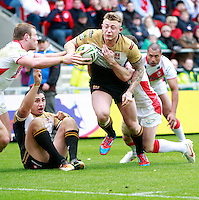 PICTURE BY CHRIS MANGNALL /SWPIX.COM...Rugby League - Super League  - St Helens Saints v Wigan Warriors  - Langtree Park, St Helens, England  - 06/04/12... St Helens Josh Jones and Lance Hohaia  manage to prevent  Wigans Josh Charnley from scoring