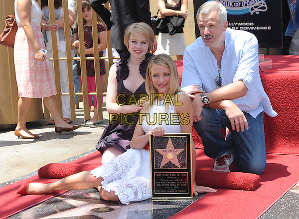 SOFIA VASSILIEVA, CAMERON DIAZ & NICK CASSAVETES.Cameron Diaz Honored With A Star On The Hollywood Walk Of Fame, Hollywood, California, USA..June 22nd, 2009     .full length sitting white lace dress plaque purple jeans denim blue shirt kneeling                                                                .CAP/DVS.©Debbie VanStory/Capital Pictures.