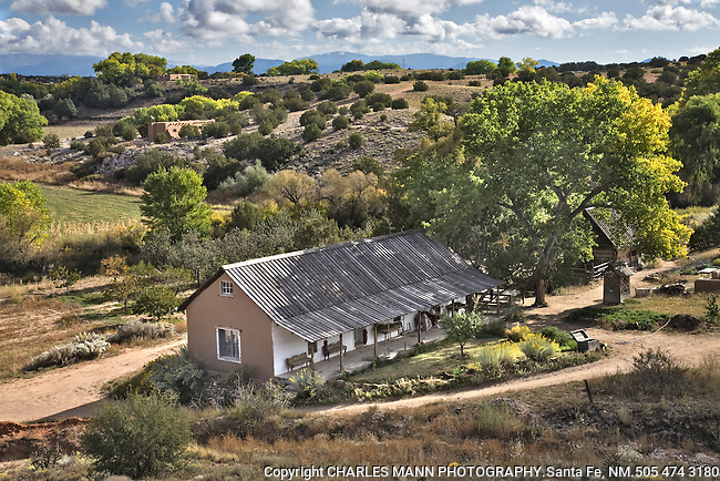 A morning  view from a hilltop looks down on the pastures and buildings at Rancho de Las Golondrinas an historical museum near Santa Fe, New Mexico