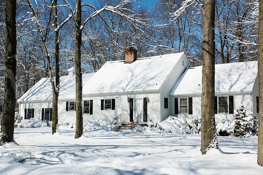 Snow falls outside a rural house, New Jersey, USA