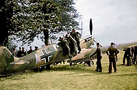 BNPS.co.uk (01202 558833)<br /> Pic: NikColeman/PBS/BNPS<br /> <br /> A Spitfire 1a captured at Dunkirk and converted into German markings is examined by Luftwaffe ground crew.<br /> <br /> Remarkable photos revealing how the Germans tried to create a super plane during WW2 by combining a captured Spitfire's frame with a Daimler Benz engine have been revealed.<br /> <br /> A new documentary series called Plane Resurrection by PBS America historian Ian McLachlan reveals how the Nazi's stuck their impressive power plant from a Bf 109 fighter on the body of a captured Spitfire V b that had crash-landed on the occupied island of Jersey in November 1942.<br /> <br /> It was piloted by German born Free French pilot Lt Bernard Scheidhauer, who had joined the RAF's 101 Sqn to fight against his homeland. <br /> <br /> While the hybrid plane looked ungainly, it was actually found during testing to out perform both the German and British fighters.<br /> <br /> However it was the only one ever made, mainly because there were not enough captured Spitfires available for the Germans to mass-produce. <br /> <br /> After capture the unfortunate Scheidhauer was sent to Stalag Luft III, where he took part in the Great Escape, pairing up with its mastermind Squadron Leader Roger Bushell, after recapture they were notoriously murdered by the Gestapo.