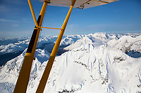 Spring landscape aerial view of snow-covered Chugach Mountains in southcentral Alaska  through the strut of a super cub airplane<br /> <br /> (C) Jeff Schultz/SchultzPhoto.com