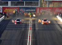 Feb 23, 2018; Chandler, AZ, USA; NHRA funny car driver Cruz Pedregon (left) races alongside Bob Tasca III during qualifying for the Arizona Nationals at Wild Horse Pass Motorsports Park. Mandatory Credit: Mark J. Rebilas-USA TODAY Sports