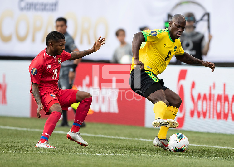 PHILADELPHIA, PA - JUNE 30: Alberto Quintero #19 defends against Dever Orgill #6 during a game between Panama and Jamaica at Lincoln Financial Field on June 30, 2019 in Philadelphia, Pennsylvania.