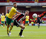 Grant Hanley of Norwich City challenges Chris Basham of Sheffield Utd during the Championship match at Bramall Lane Stadium, Sheffield. Picture date 16th September 2017. Picture credit should read: Simon Bellis/Sportimage