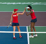 Venus Williams (white visor) and Anastasia Rodionova of the Kastles play at the World Team Tennis match between the Washington Kastles and the Boston Lobsters on July 16, 2012 in Washington, DC.