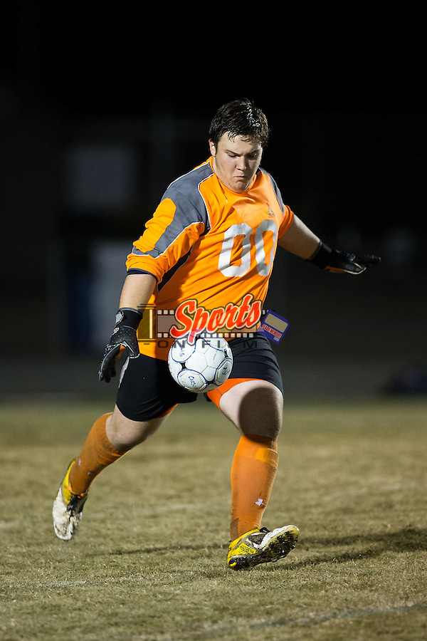 Grayson Owens (00) of the Carson Cougars kicks the ball during second half action against the North Iredell Raiders at Jesse C. Carson High School on November 5, 2015 in China Grove, North Carolina.  The Cougars defeated the Raiders 5-1 in the first round of the 2015 NCSHAA 3A playoffs.  (Brian Westerholt/Sports On Film)