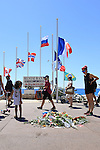 The crowd gather on the French Riviera at makeshift memorials on the 'Promenade des Anglais' in Nice, France on July 17, 2016,  in tribute to the victims of the Bastille Day attack, July 14, 2016 that left 84 dead. ISIS, Daech group claimed responsibility for the truck attack driven by Tunisian Mohamed Lahouaiej-Bouhlel, 31, smashed a 19-tonne truck into a packed crowd. Photo:Pierre Teyssot