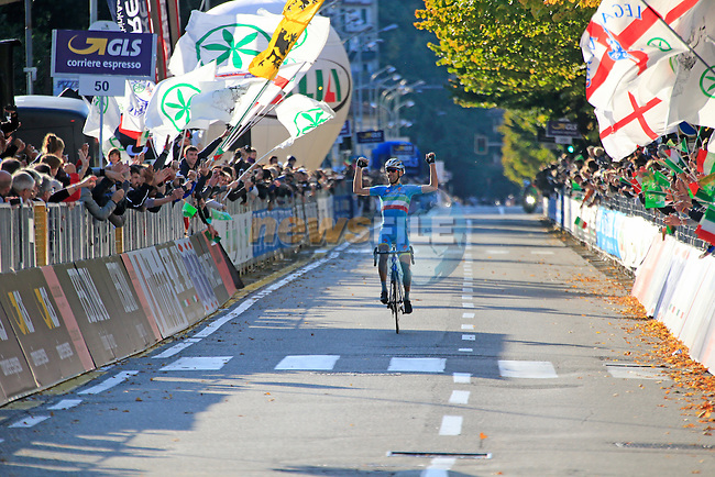 Italian National Champion Vincenzo Nibali (ITA) Astana crosses the finish line in Como to take victory at the end of Il Lombardia 2015 running 245km from Bergamo to Como, Italy. 4th October 2015.<br /> Picture: Eoin Clarke | Newsfile