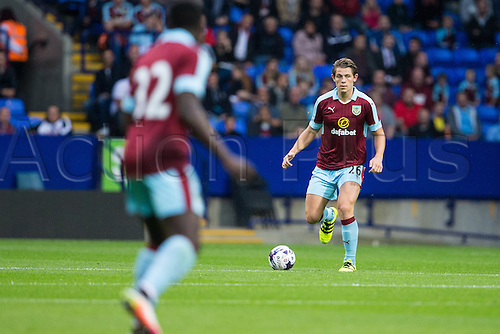 26.07.2016. Macron Stadium, Bolton, England. Pre Season Football Friendly. Bolton Wanderers versus Burnley. Burnley FC defender James Tarkowski brings the ball out of defense