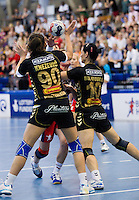 30 MAY 2012 - LONDON, GBR - Lyn Byl (GBR) of Great Britain (centre mainly hidden, in red and blue) finds her path to goal blocked by Milena Knezevic (MNE) (left) and Andjela Bultovic (MNE) (right), of Montenegro, during the women's 2012 European Handball Championship qualification match at the National Sports Centre in Crystal Palace, Great Britain (PHOTO (C) 2012 NIGEL FARROW)
