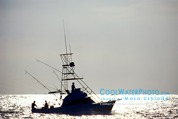 sport fishing boat, trolling at sunset, Kona, Big Island, Hawaii