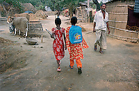 Rupali Khatun (L) and Banna Khatun walk through their village of Kalinagar to the  spot where the school boat will pick them up. (Photo by Tadej Znidarcic)
