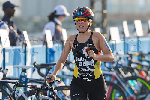 05.03.2016. Abu Dhabi, UAE. 2016 ITU Abu Dhabi World Triathlon.  Hanna Philippin falls in the bike transition area and holds her running shoe in hand