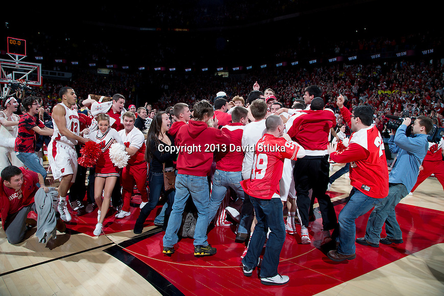 Wisconsin Badgers fans rush the court after a Big Ten Conference NCAA college basketball game against the Michigan Wolverines Saturday, February 9, 2013, in Madison, Wis. The Badgers won 65-62 (OT). (Photo by David Stluka)