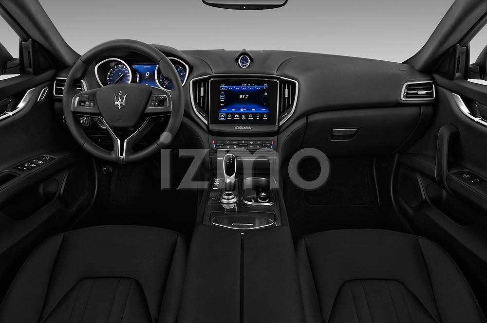 Stock photo of straight dashboard view of a 2018 Maserati Ghibli Base 4 Door Sedan