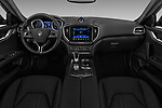 Stock photo of straight dashboard view of a 2018 Maserati Ghibli Base 4 Door Sedan