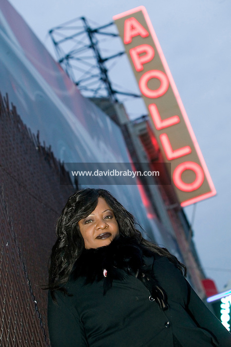 28 December 2006 - New York City, NY - French singer and runner-up of La Nouvelle Star TV show, Miss Dominique stands in front of the Apollo theatre in New York City, USA, on the day James Brown's body lay there in repose.
