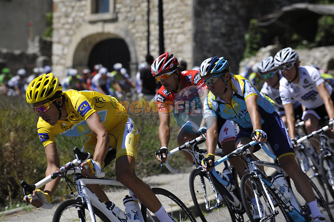 The peleton led by Astana team including race leader Alberto Contador (ESP) pass through the medieval village of Salles Sous Bois during the penultimate Stage 19 to Mont Ventoux during the Tour de France 2009 running 167km from Montelimar to Mont Ventoux, France. 25th July 2009 (Photo by Eoin Clarke/NEWSFILE)