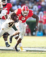 ATHENS, GA - SEPTEMBER 7: Zamir White #3 makes a run with Murray State's Don Parker #48 attempting to stop him during a game between Murray State Racers and University of Georgia Bulldogs at Sanford Stadium on September 7, 2019 in Athens, Georgia.