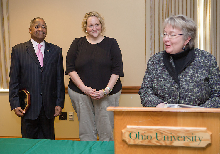 Ohio University President Roderick McDavis and Executive Vice President and Provost Pam Benoit congratulate Jenny Chabot during the Presidential Teacher Awards in the Multicultural Center on Sept. 23, 2014. Photo by Lauren Pond