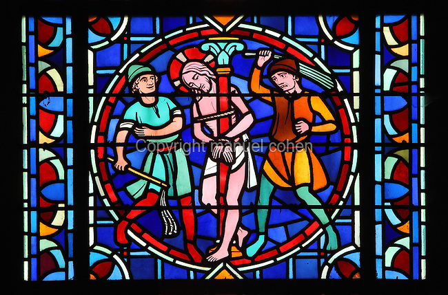 The scourging of Christ, with 2 men whipping Christ, who is tied to a pillar, stained glass window, Laon Cathedral or the Cathedrale Notre-Dame de Laon, built 12th and 13th centuries in Gothic style, in Laon, Aisne, Picardy, France. The cathedral is listed as a historic monument. Picture by Manuel Cohen