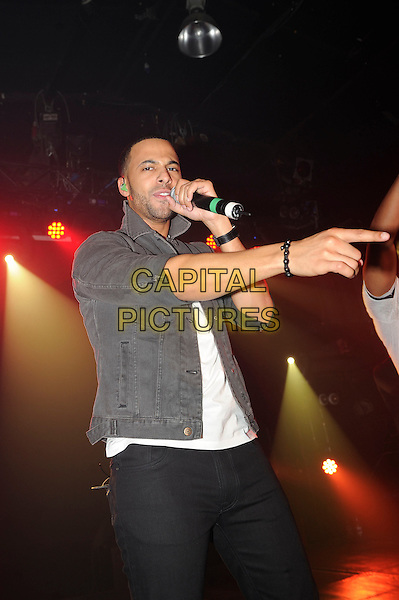 Marvin Humes.JLS performing live at G-A-Y, Heaven Nightclub, London, England. .27th October 2012.on stage in concert gig performance performing music half length black jeans denim grey gray jacket singing hand arm.CAP/MAR.© Martin Harris/Capital Pictures.